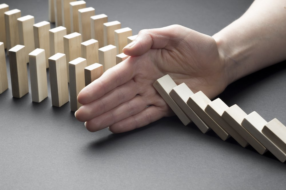 businessman-hand-stop-domino-continuous-tipping-risk-strategy-business